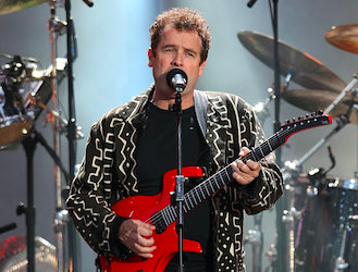 Johnny Clegg performs during the 46664 concert honouring Nelson Mandela's 90th birthday in Hyde Park, London. Credit to Times Live/Ian West/PA Images via Getty Images