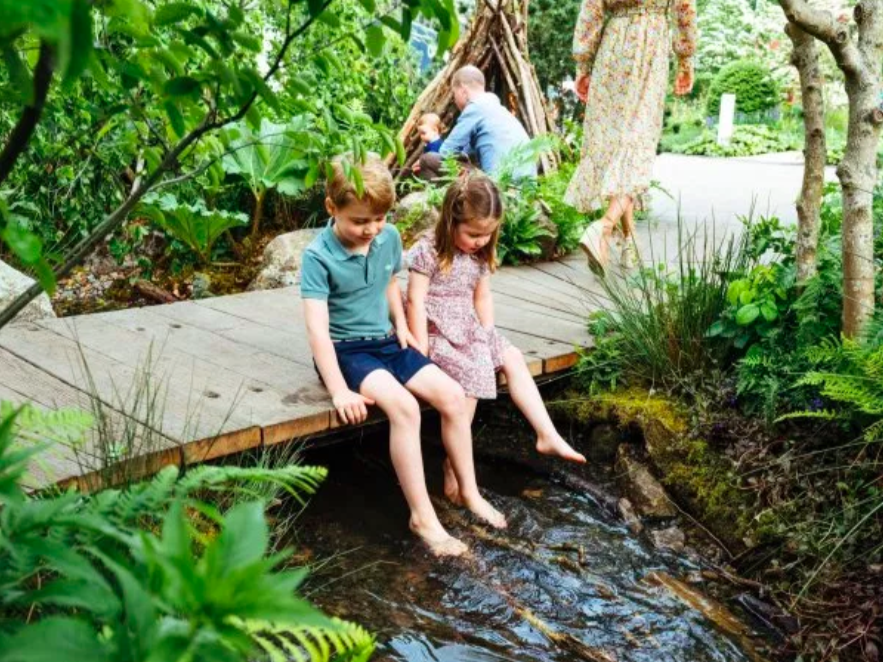 George and Charlotte as they inspected their mum's Chelsea Flower Show garden. Credit: Rex