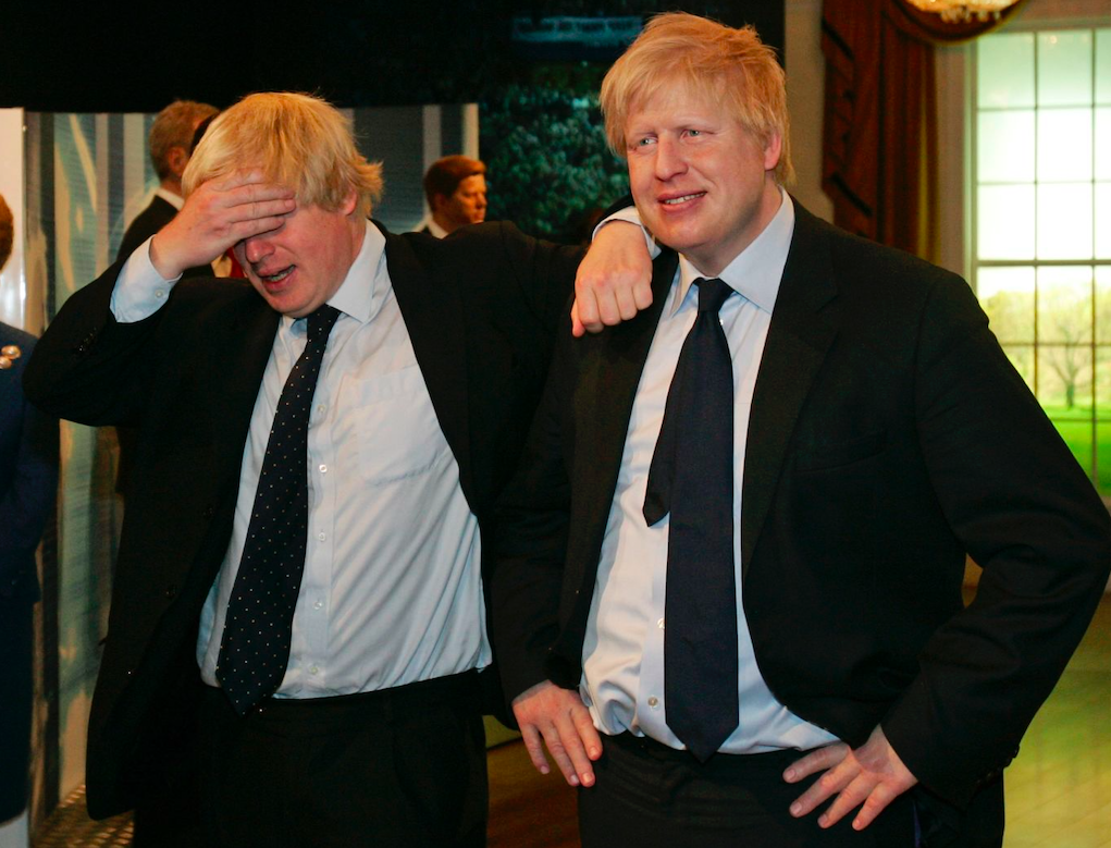Boris Johnson (left) poses with a wax figure of himself (right) at Madame Tussauds in London, May 2009. Credit: Sang Tan/AP